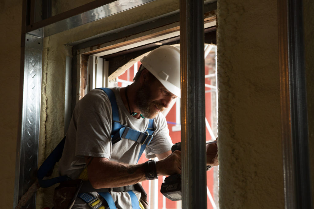 Our Work - Work begins on installing windows to renovation project