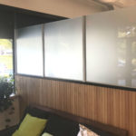 Frosted glass install in entry of American Meadows