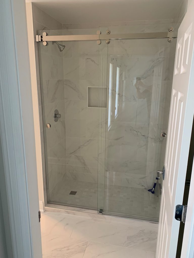 Front view of glass shower with sliding doors
