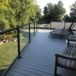 An example of exterior glass railing on a patio or deck
