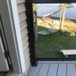 Glass Railing provides homeowners with a sturdy support that doesn't impede the view of the lake