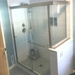 Full shower enclosure with side half wal