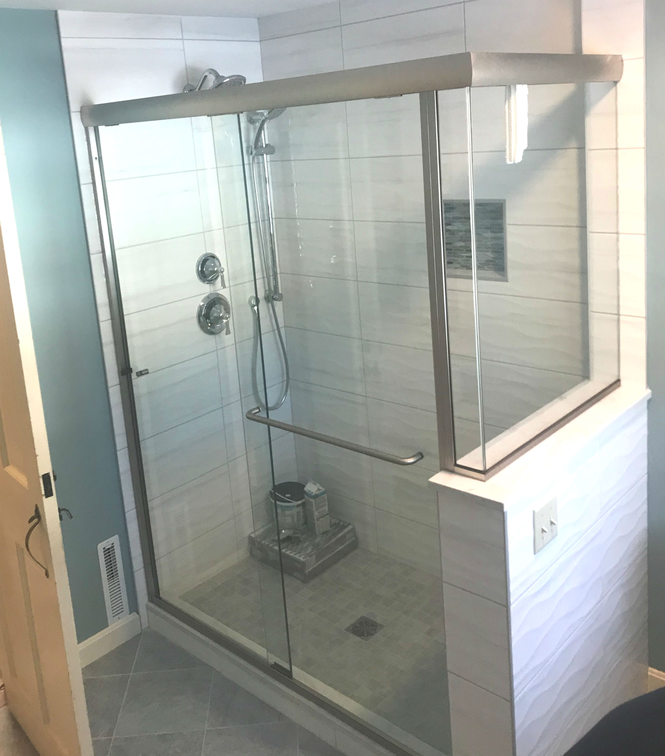 teal bathroom with white wave tile shower - Acme Glass